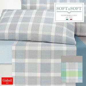 lenzuola letto singolo Gabel tinta unita con bordo a contrasto, colore beige con bordo giallo, celeste con bordo azzurro, e rosa con bordo fuxia