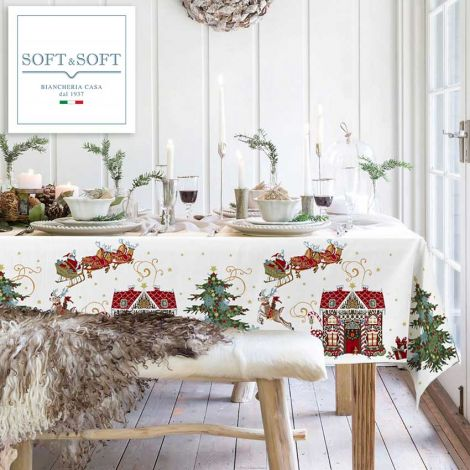 tovaglia natalizia a base bianco latte stampata con disegni natalizi babbo natale renne, albero di natale e casetta di marzapane